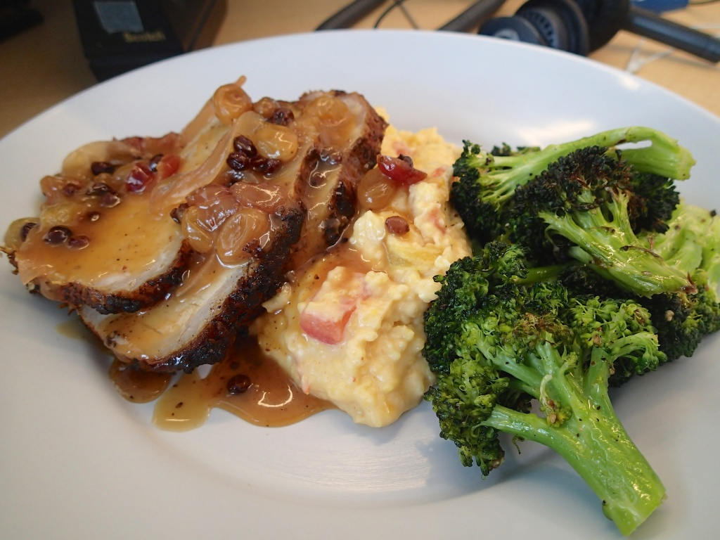 Roasted Pork Tenderloin with Grits and Broccoli covered in a raisin reduction , at work