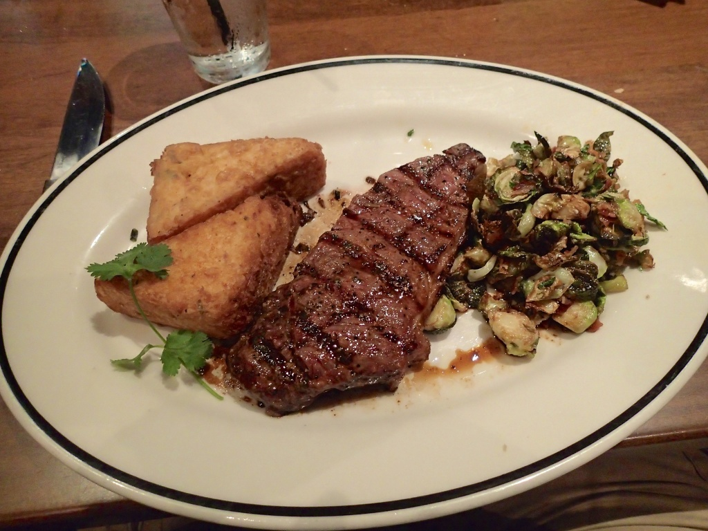 NY strip Thin, with Brussel sprouts and Potato Croquet at Black finn Ameripub