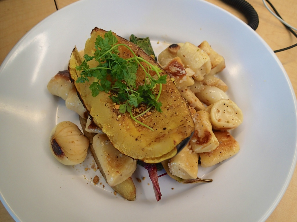 Acorn Squash with root vegetables and potato gnocchi at work